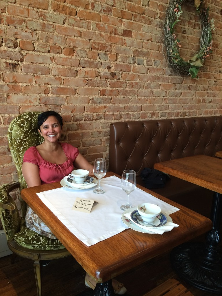 Luxuriating in a soft, vintage armchair, awaiting our high tea