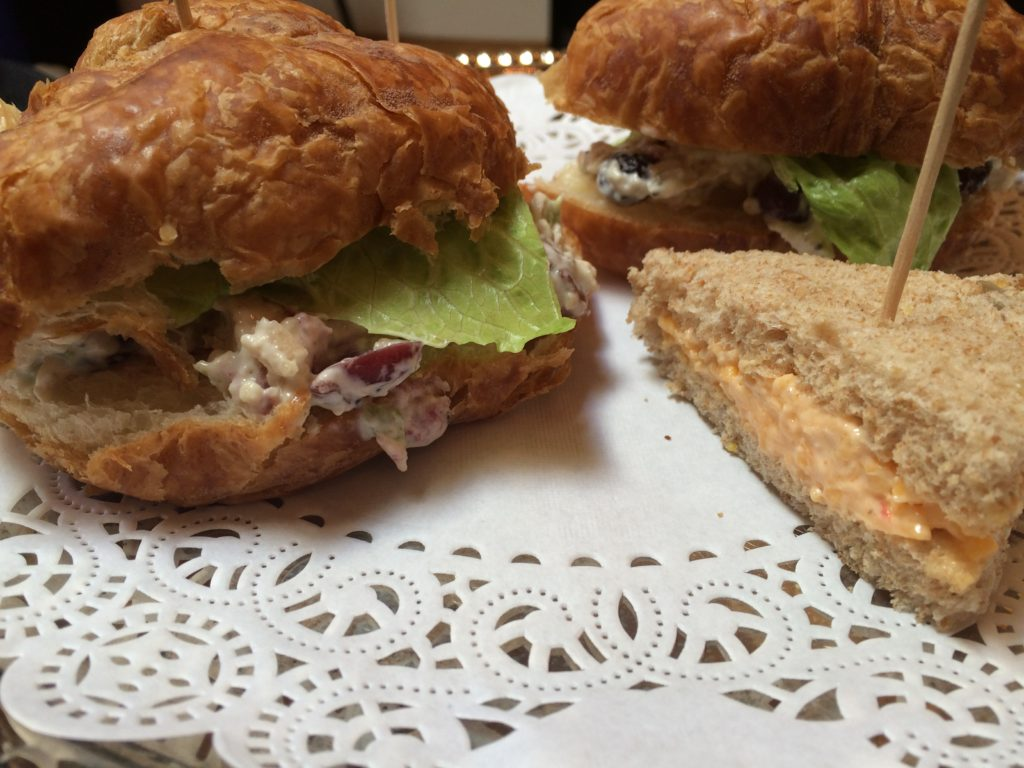 Sandwiches are pimiento cheese on wheat and chicken salad croissant