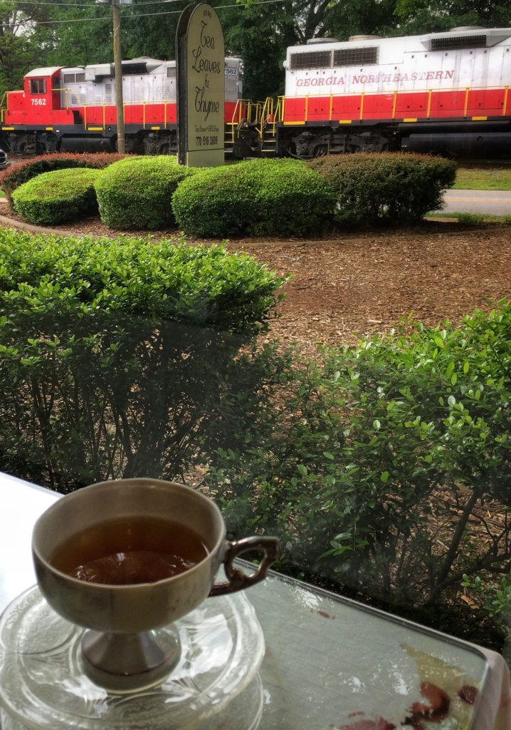 Watching the trains go by, as we sip from dainty china