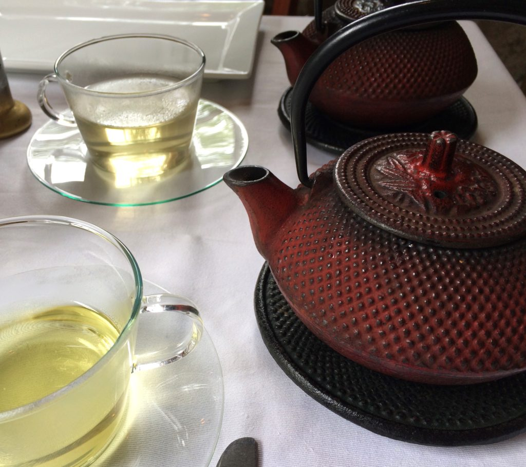 Tea is served in cast iron teapots and glass teacups