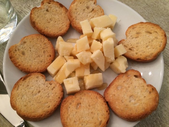 English cheddar drizzled with honey accompanies the savories course. Our hosts check that we are getting enough to eat - YES!