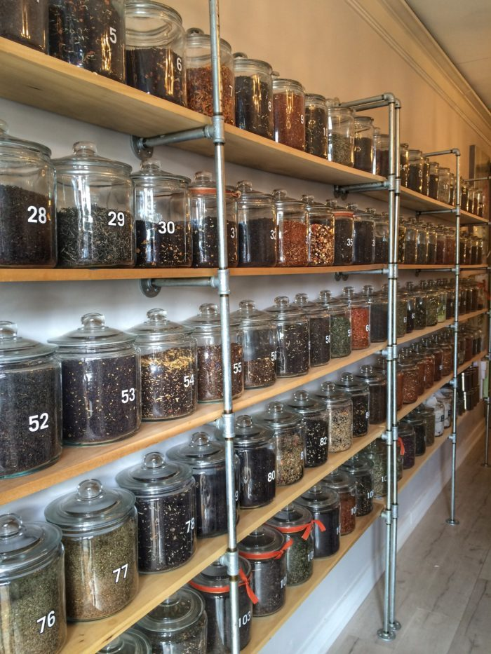 Wall of loose leaf teas at Urban Tea