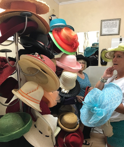 Choosing our hats at Calabash Garden afternoon tea