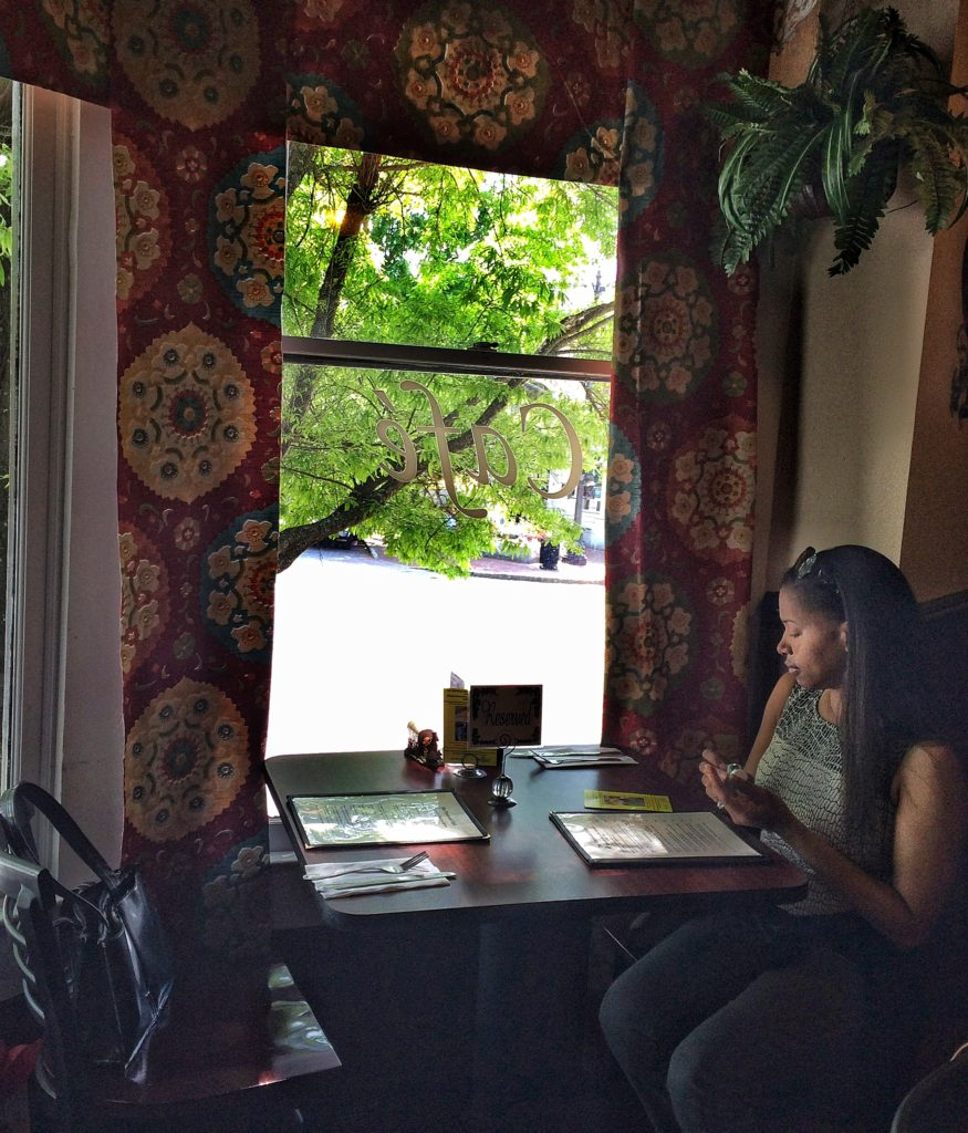 Request a window seat when you reserve to sip your tea overlooking the square.