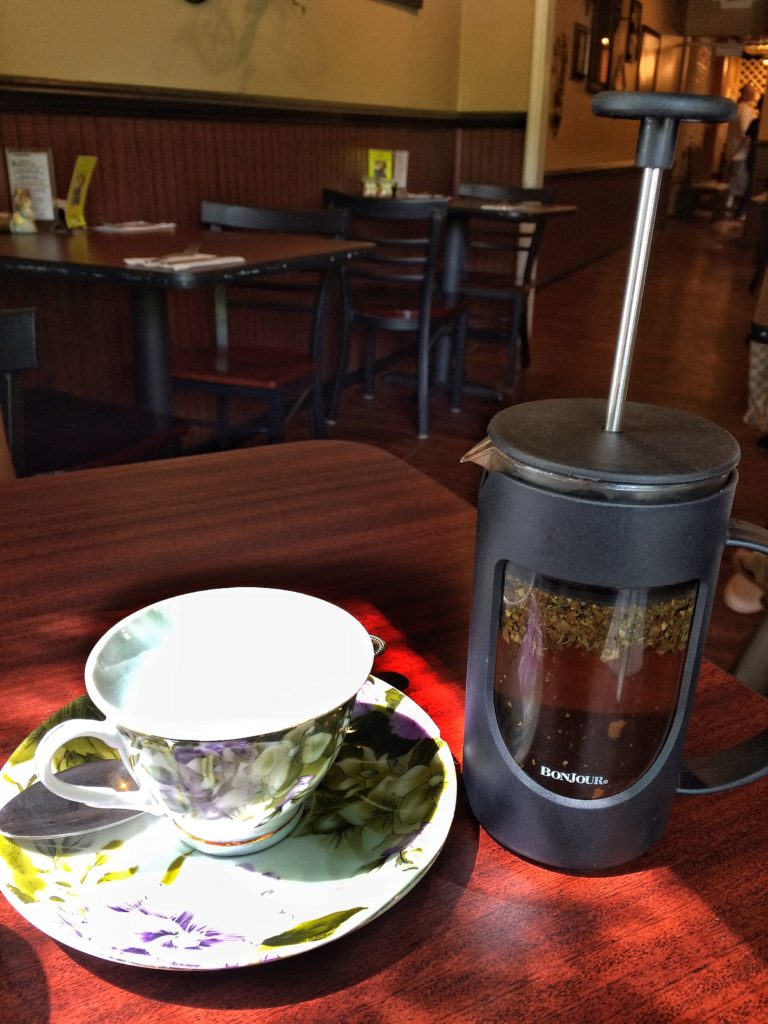 Your server lets you know how long to let your tea steep before you press, and will replenish your hot water for a second serving. If your French press lets some leaves into the cups, wait a moment for them to fall to the bottom, then enjoy!