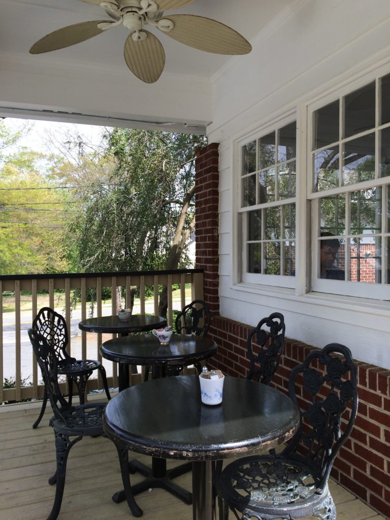 A back patio offers a breezy atmosphere for tea