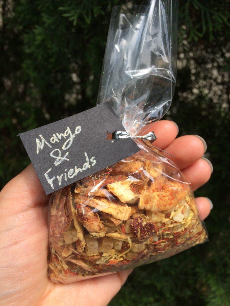 Sneak peek at the next seasonal tea: Mango & Friends. Loose leaf teas and artwork are for sale.