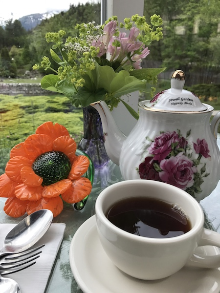 Blown glass centerpieces and rose tea at Jewell Gardens
