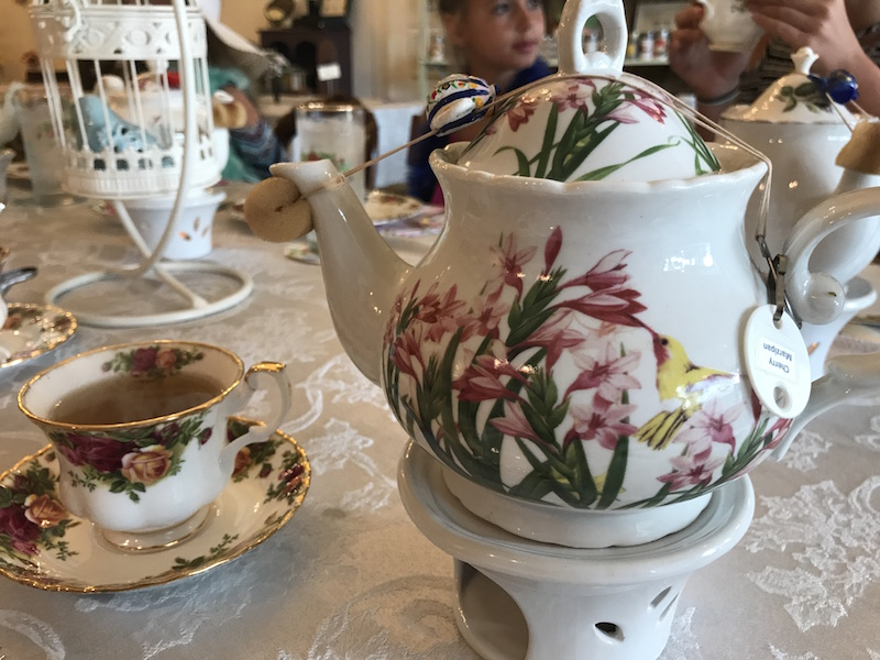 Tea pots with drip catchers, labels and warmers at Whitney's Tea Room afternoon tea