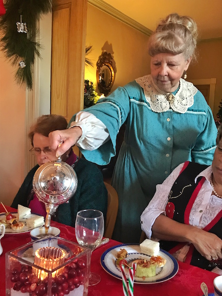 Docent pouring tea at Bulloch Hall in Roswell, GA
