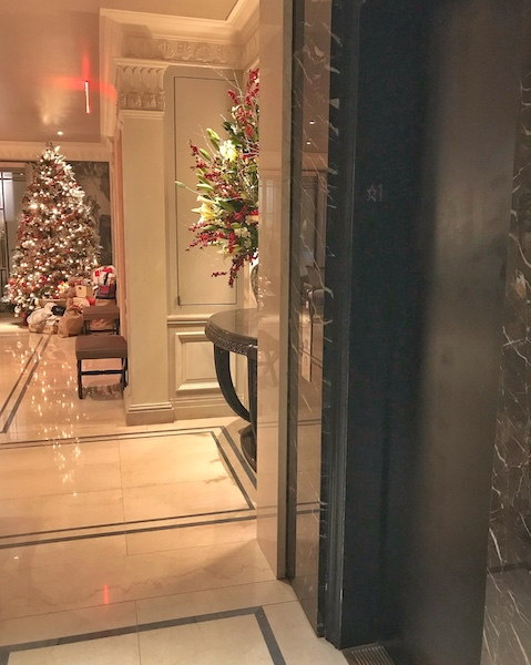Holiday decorations in the quiet lobby; the elevator to the upstairs Pembroke Room