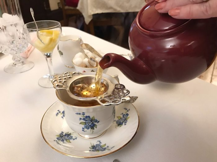pouring tea at Hearts Desire Tea Room, Alabama