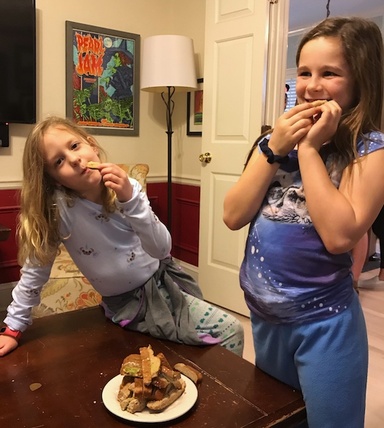 girls eating crusts at girl scout tea