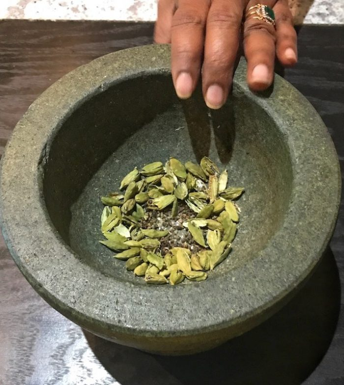 Cardamom seeds in the mortar and pestle