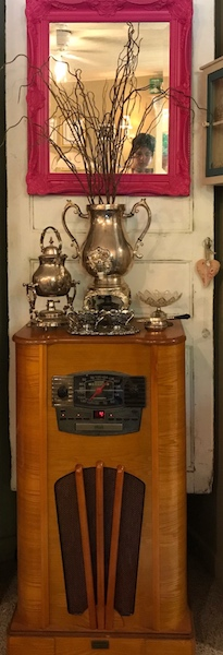 Silver tea seat on antique radio at A Southern Cup in Hendersonville, NC