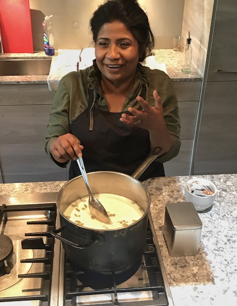 Asha Gomez prepares chai in The Third Space in Atlanta, GA