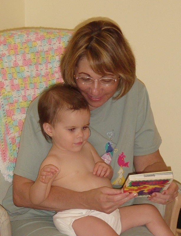 Grandma reading to baby