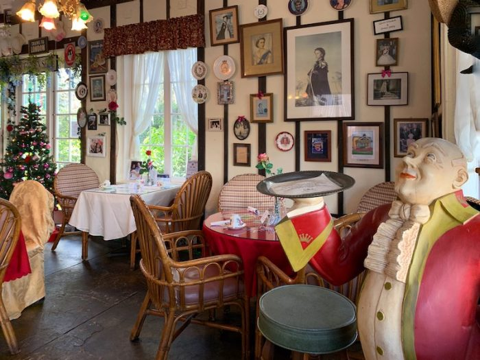 butler welcomes you at Windsor Rose Tea Room & Restaurant for afternoon tea in Mount Dora, FL