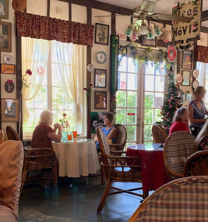 table by the window at Windsor Rose Tea Room & Restaurant for afternoon tea in Mount Dora, FL