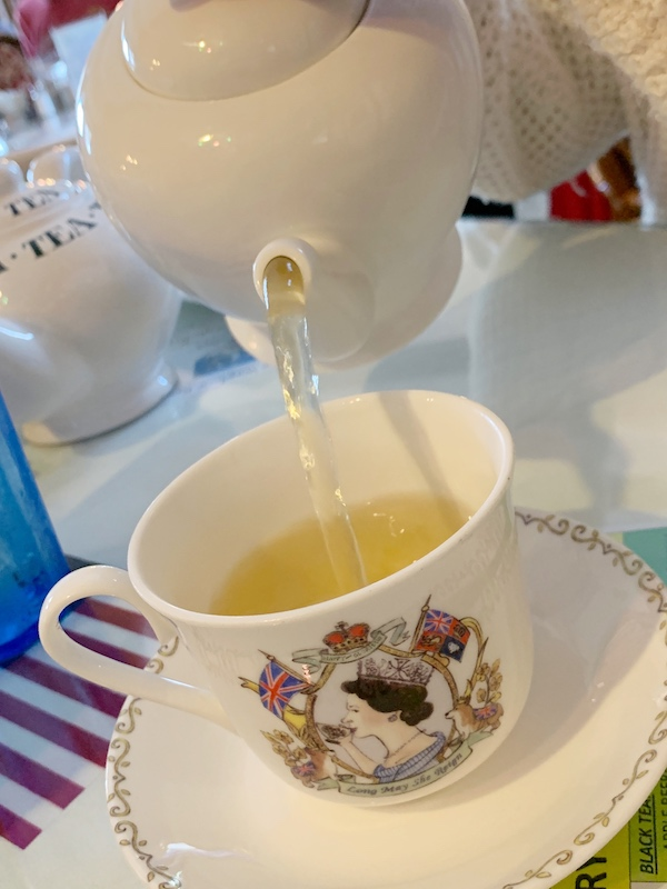 tea is poured at Windsor Rose Tea Room & Restaurant for afternoon tea in Mount Dora, FL
