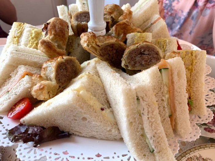 tea sandwiches and sausage rolls at Afternoon tea at The Olde English Creamery in historic Pensacola, FL
