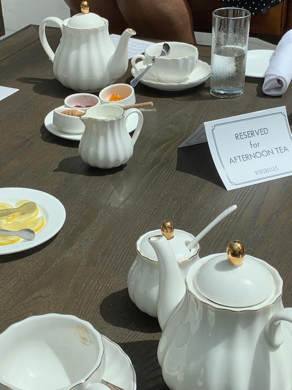 teapots and teacups at afternoon tea at Château Élan in Braselton, GA