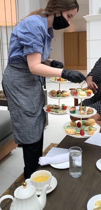 tea trays arrive at afternoon tea at Château Élan in Braselton, GA
