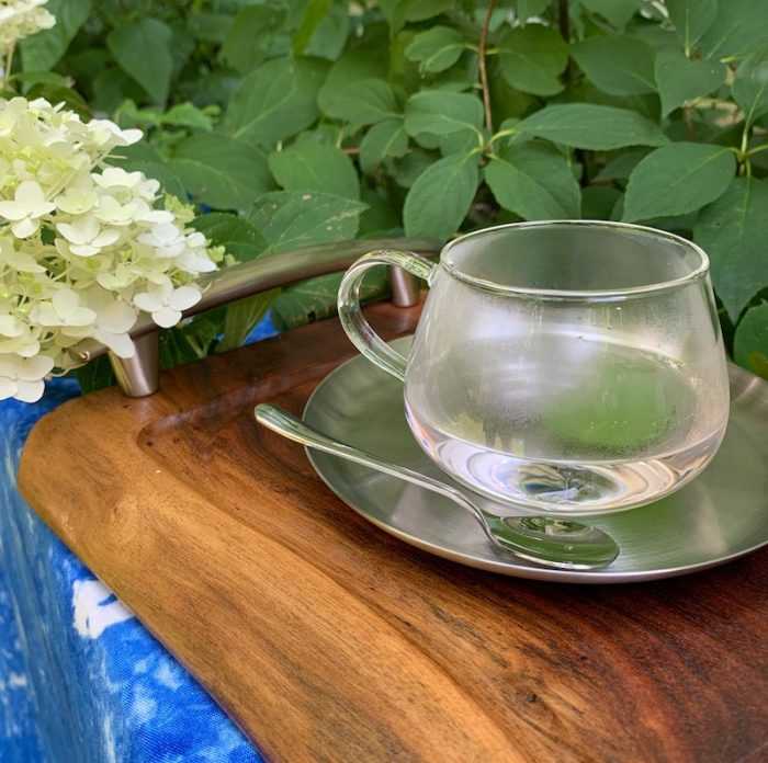Mint blueberry tea fogs the glass teacup by Elfin Collection