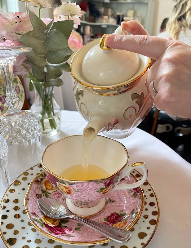 pouring tea at afternoon tea at The Ginger Room in Alpharetta, Georgia