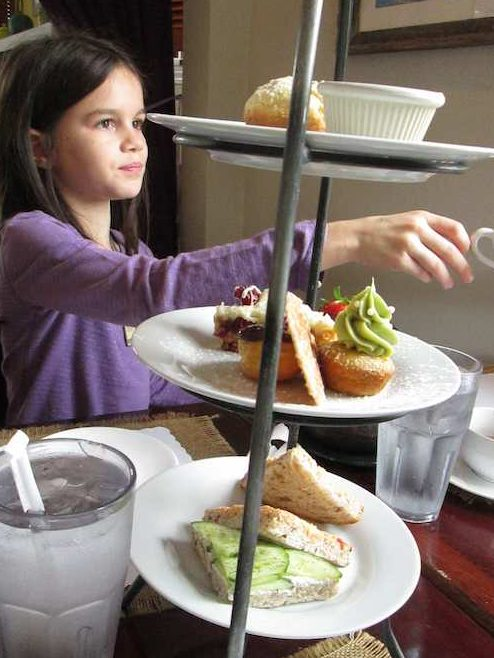 3-tiered tray with child at afternoon tea