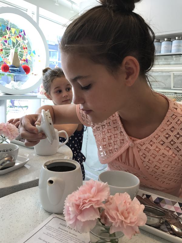 smelling the tea at afternoon tea with girls