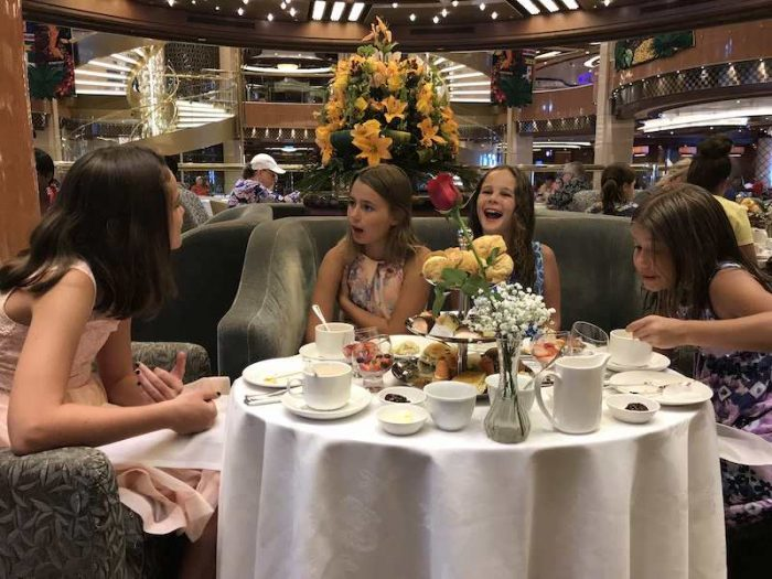 cousins chatting at afternoon tea