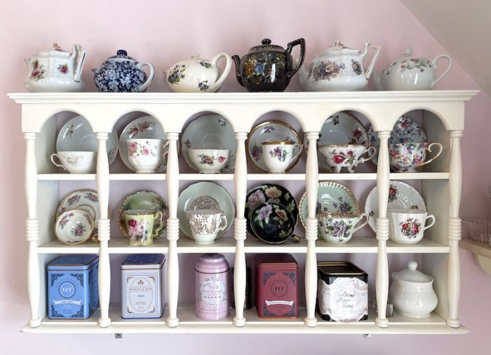 teacups in a curio at afternoon tea at Stillwater Tea House in Suffolk, VA