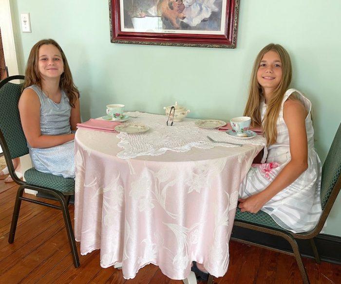cousins taking tea at afternoon tea at Stillwater Tea House in Suffolk, VA