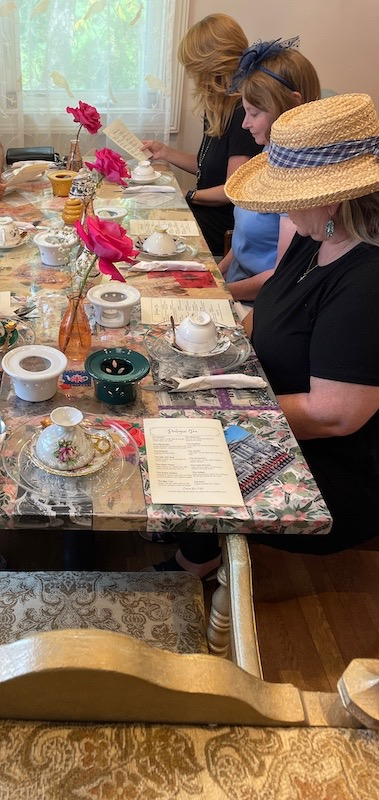 selecting teas at afternoon tea at The Book & Bee Cafe & Tea in Hendersonville
